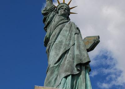 Statue of Liberty, this statue is a miniature of her bigger sister in New York Harbour. In fact, this statue faces the direction of her bigger sister (west).