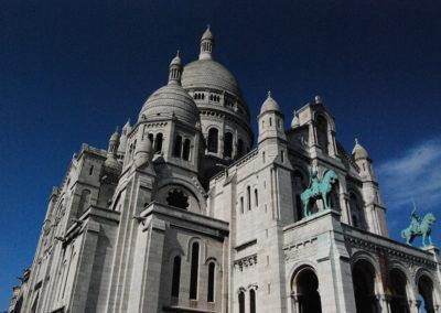 Sacre Coeur Basilica, an iconic landmark this white domed cathedral is on Butte Montmartre